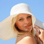 woman-in-sun-hat-fighting-wrinkles