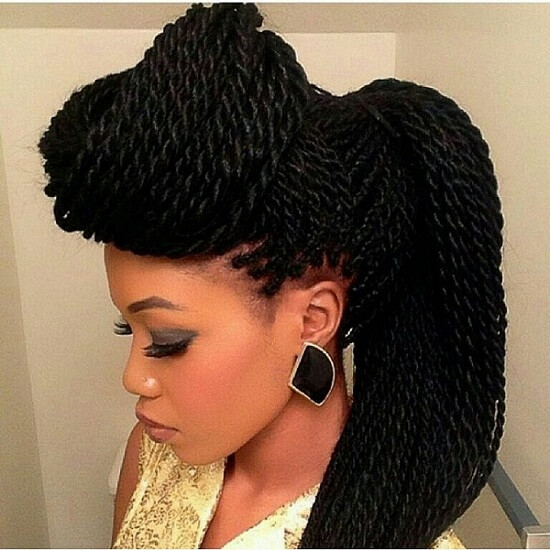an interesting and cool protective hairstyle worn by a young woman