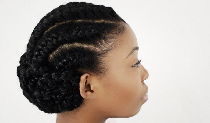 an african american woman with a cornrow bun hairstyle
