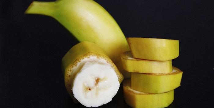 a sliced banana in its peel