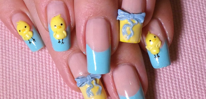 a 3D baby chick manicure with yellow and blue polish