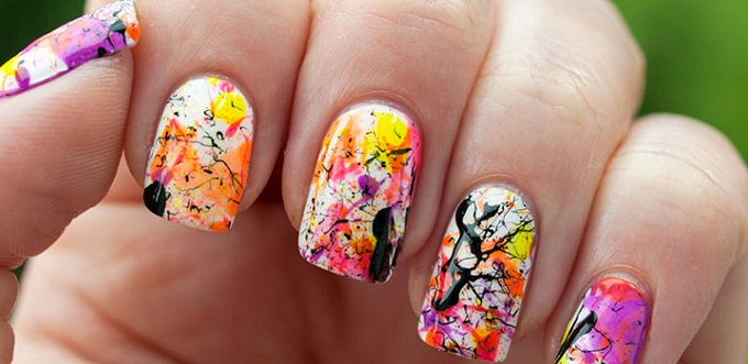 beautiful abstract art on a woman's nails