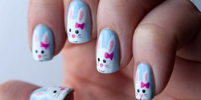 a woman showing off her manicure with a Easter-related design