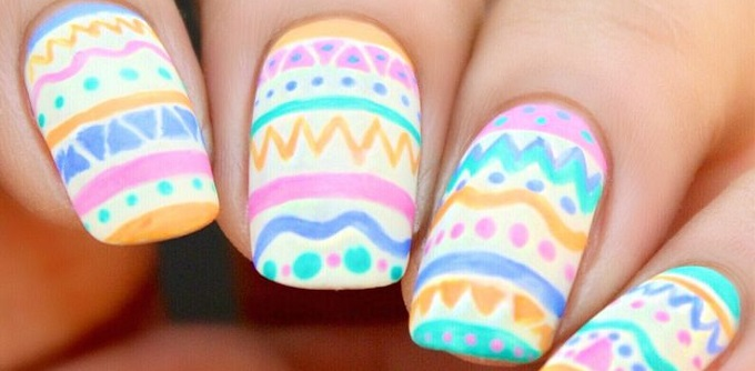 an Easter eggs design on someone's nails