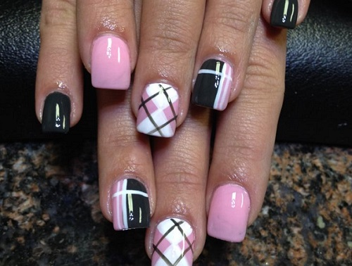 a pastel plaid pattern on a woman's nails