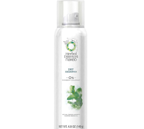 a white bottle of Herbal Essences dry shampoo