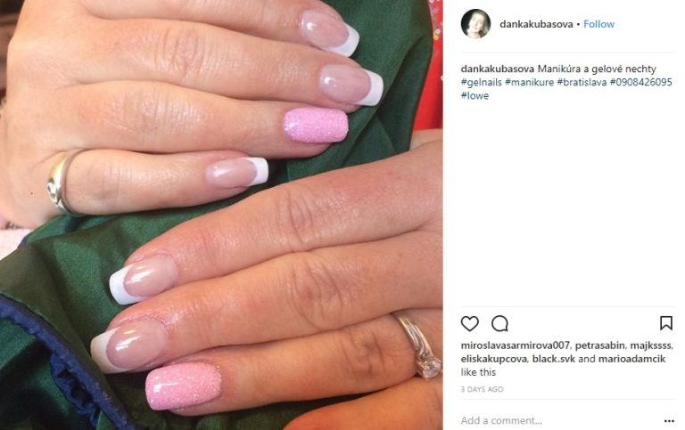Gel nails with a French manicure design.