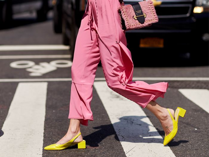 woman in pink outfit and yellow footwear