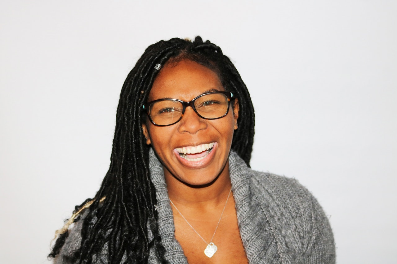 Woman with dreadlocks smiling
