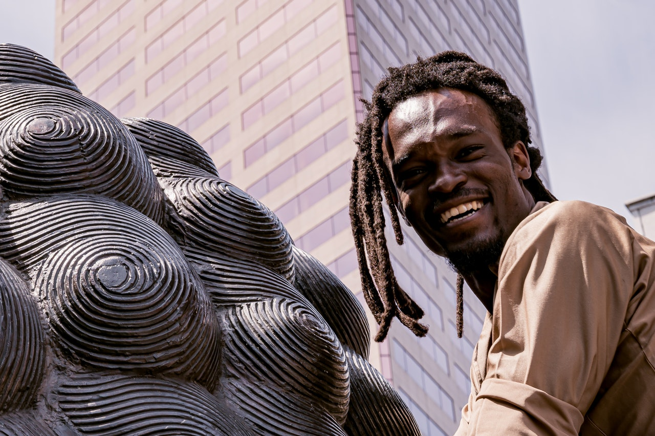 Man with dreadlocks smiling