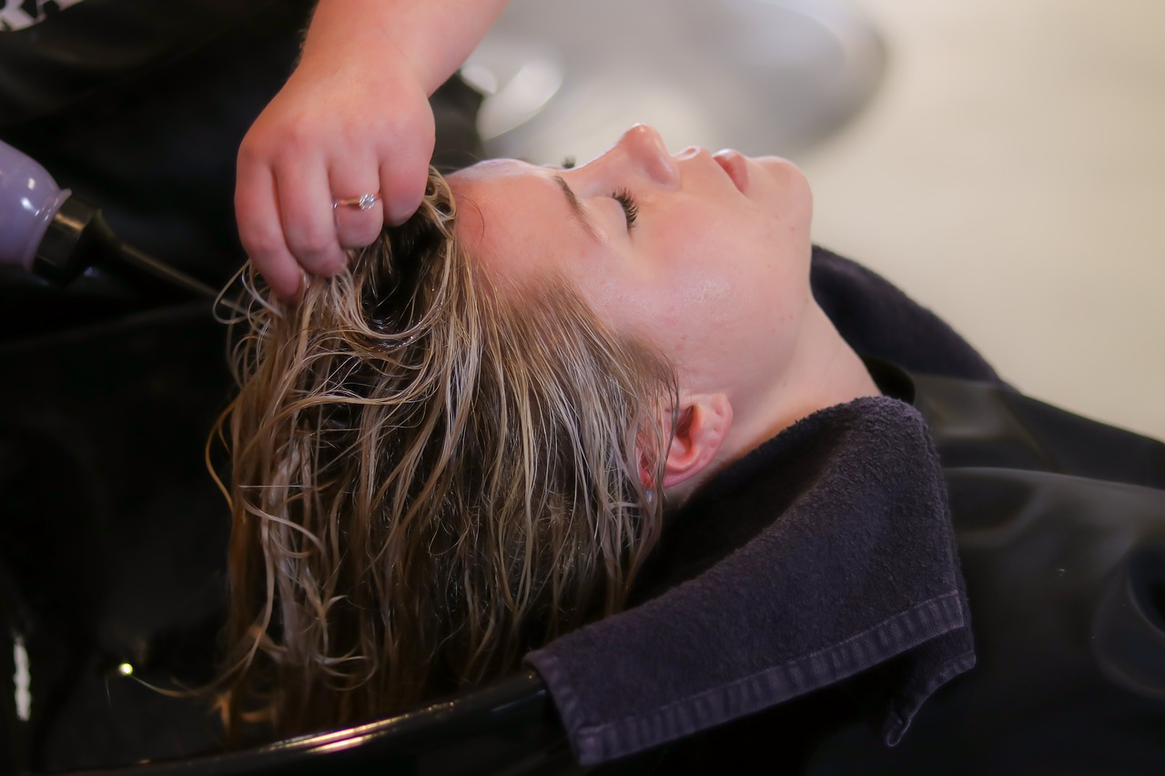 woman getting her hair washed at the salon