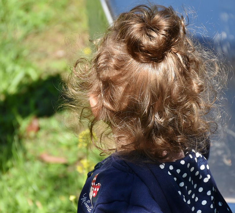 Child with curly hair