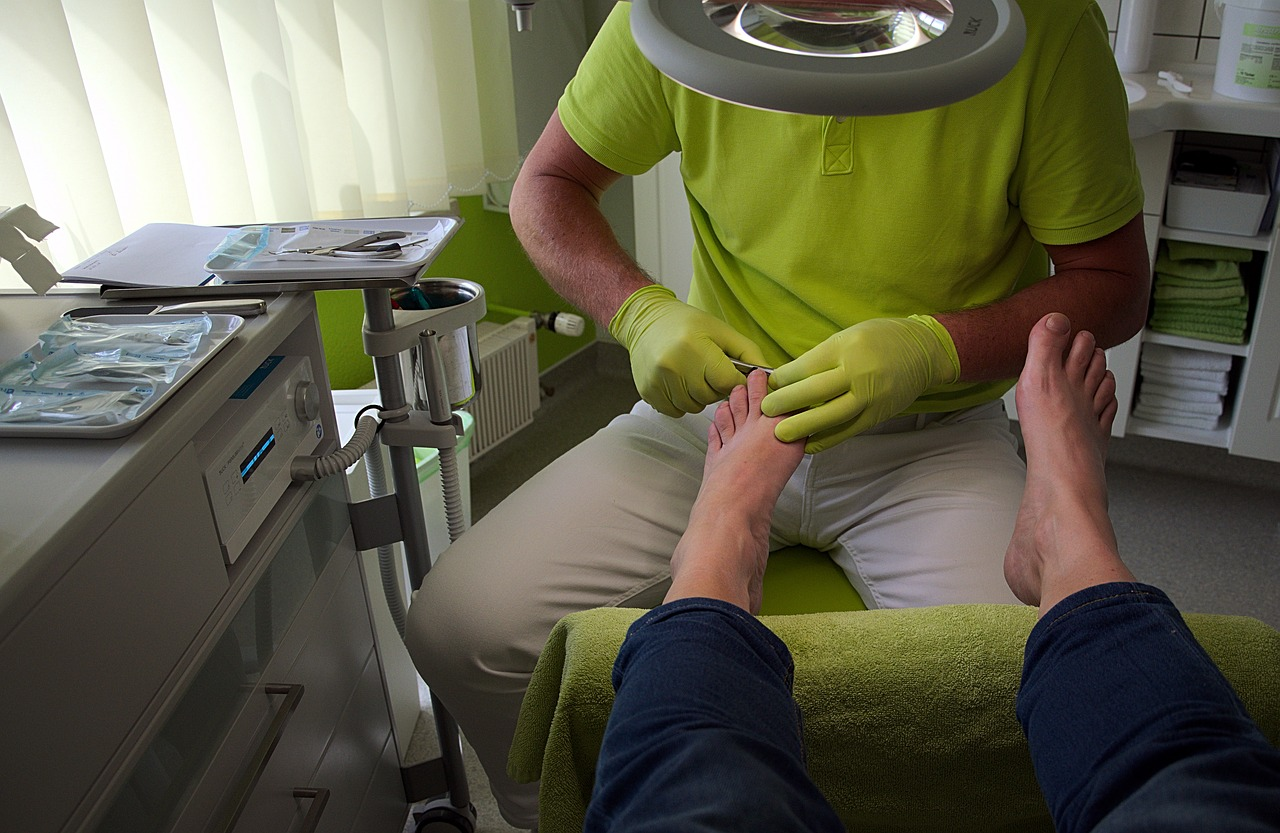 Mans foot having a pedicure